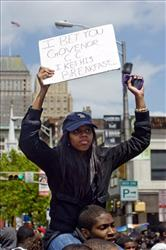 Kylah Broughton, a senior at Newark's Science Park High School, joins a protest against budget cuts earlier this year.