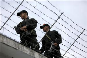 Jail guards secure a detention center in the Philippines.