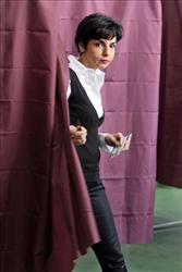 French Justice Minister Rachida Dati exists a polling booth after casting her vote for the European elections in Paris, Sunday, June 7, 2009.