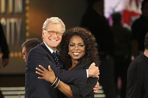This photo, supplied by Harpo Productions, shows Oprah Winfrey welcoming first-time guest David Letterman to her 22nd season premiere at Madison Square Garden on Sept. 10, 2007. in New York.