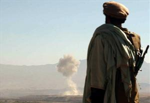 A Northern Alliance fighter views a US strike on a Taliban-held village in the early days of the war.