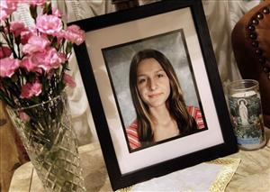 In this Sept. 1, 2010 photo, a portrait of Sladjana Vidovic, who committed suicide in 2008, sits in the living room of her family's Mentor, Ohio home.