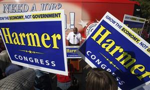 Michael Steele is seen between a pair of campaign signs for Republican congressional candidate David Harmer, during a rally in Stockton, Calif., Wednesday, Oct. 6, 2010.
