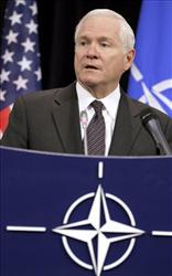 Defense Secretary Robert Gates speaks during a joint new conference with Secretary of State Hillary Rodham Clinton, not seen, Thursday, Oct. 14, 2010, at NATO headquarters in Brussels.