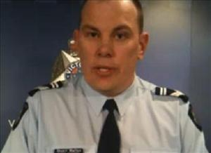 Senior Constable Stuart Walton reads out the restraining order.