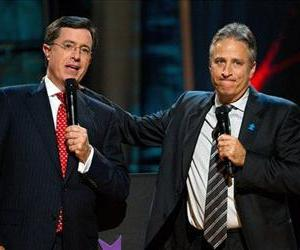 In this Oct. 2, 2010 file photo, Stephen Colbert, left, and Jon Stewart appear on stage at Comedy Central's  'Night Of Too Many Stars: An Overbooked Concert For Autism Education.'