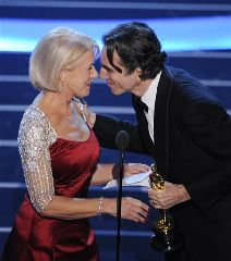 British actor Daniel Day-Lewis accepts the Oscar for best actor for his work in There Will Be Blood from presenter Helen Mirren at the 80th Academy Awards Sunday, Feb. 24, 2008, in Los Angeles.  (AP Photo/Mark J. Terrill)