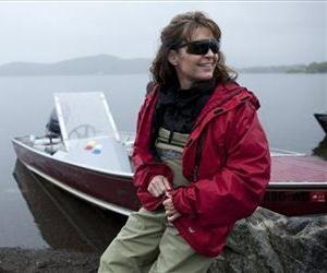 In this July 2, 2010 publicity image released by TLC, former Republican vice presidential candidate and Alaska Gov. Sarah Palin is shown by the family boat in Dillingham, Alaska.