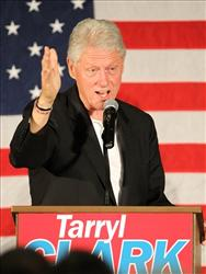 Bill Clinton talks at a rally in Minnesota on Oct. 24.