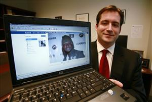 In this Oct. 13, 2009, file photo, Assistant US Attorney Michael Scoville displays part of the Facebook page, and an enlarged profile photo, of fugitive Maxi Sopo in Seattle.