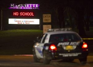 A police vehicle blocks the driveway to Marinette High School Tuesday morning.