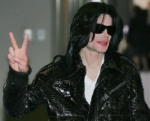Michael Jackson flashes a V-sign to Japanese media upon his arrival at Narita international airport, near Tokyo in this 2007 file photo. Jackson faces losing his Neverland ranch because of $24.5 million outstanding balance. (AP Photo/Itsuo Inouye)