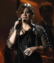 Kelly Clarkson's fans tipped her off about the stolen songs.