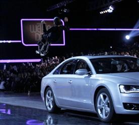 Contestant Samuel Koch, wearing spring shoes, attempts to jumps over a moving car, driven by his father, during the live broadcast of  'Wetten dass ?' (Bet it?), a top show  of German TV channel ZDF in Duesseldorf, western Germany, Saturday Dec. 4, 2010. Koch failed during his attempt, crashed on...