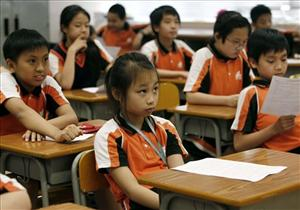 Students have a lesson at a primary school in Hong Kong Thursday, June 11, 2009.