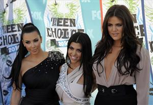 In this Aug. 8, 2010 file photo, from left, Kim Kardashian, Kourtney Kardashian and Khloe Kardashian arrive at the Teen Choice Awards in Universal City, Calif.