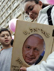 In this 2006 Israeli schoolchildren carrying an Ariel Sharon photo album to present to Israel's ill prime minister, at the Hadassah Ein Kerem hospital in Jerusalem. Ariel Sharon turned 80 years old yesterday, still in the coma he fell into more than two years ago.  (PATRICK BAZ/AFP/Getty Images