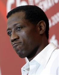 In a Tuesday, Sept. 8, 2009 file photo, actor Wesley Snipes poses during the photo call for the film Brooklyn's Finest at the Venice Film Festival in Venice, Italy.