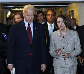 Vice President Joe Biden, left, and House Speaker Nancy Pelosi talk as they leave a Democratic Caucus meeting on Capitol Hill in Washington, Wednesday, Dec. 8, 2010.