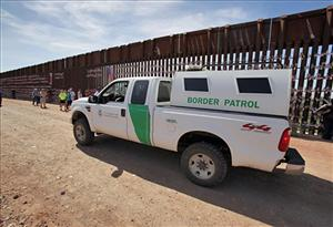 A U.S. Customs and Border Patrol agent patrols along the Arizona-Mexico border wall in Hereford, Ariz., in this file photo.