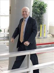 Sen. John McCain, R-Ariz., heads for the Senate floor for cloture votes on Capitol Hill in Washington, Thursday, Dec. 9, 2010.