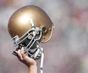 A member of Notre Dame Fighting Irish holds up his helmet in this file photo.