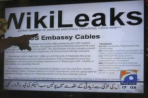 In this Thursday, Dec. 2, 2010 file picture, a man points towards the Wikileaks memos shown on a TV screen at an electronics shop in Karachi, Pakistan.