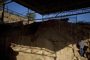 Dr. Ran Barkai from the Institute of Archeology of Tel Aviv University walks at the archeological site where ancient teeth were discovered near Rosh Haain, central Israel, Monday, Dec. 27, 2010. Israeli archaeologists say they may have found the earliest evidence yet for the existence of modern man. A Tel...