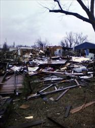 In this photo taken with a cell phone, damage to a barn and a house is shown in Cincinnati, Ark., Friday, Dec. 31, 2010.
