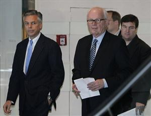 U.S. special envoy for North Korea Stephen Bosworth, right, is followed by U.S. Ambassador to China Jon Huntsman, left, as Bosworth prepares to read a statement to reporters before leaving a hotel in Beijing, China, Wednesday, Nov. 24, 2010.