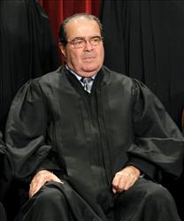 Supreme Court Associate Justice Antonin Scalia poses for last year's group portrait of the Supreme Court.