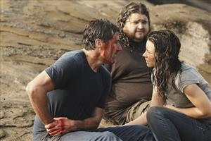 In this publicity image released by ABC, Matthew Fox, left, Jorge Garcia and Evangeline Lilly, right are shown in a scene from the finale of Lost.