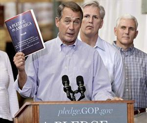 In this Sept. 23, 2010 file photo, House Minority Leader John Boehner of Ohio, left, holds up a copy of the GOP agenda, A Pledge to America, at a lumber yard in Sterling, Va.