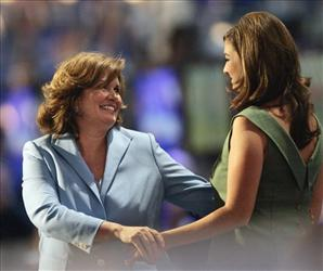 In this July 28, 2004 file photo, Cate Edwards, right, introduces her mother Elizabeth Edwards on stage during the Democratic National Convention in Boston.