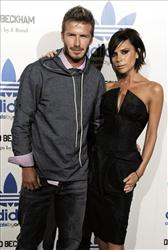 David Beckham, left, and his wife Victoria arrive to celebrate the launch of the Adidas Originals by Originals David Beckham clothing line designed by James Bond, Sept. 30, 2009, in Los Angeles.