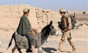 In this image made available in London, Thursday Feb. 28, 2008, Britain's Prince Harry patrols through the deserted town of Garmisir, Afghanistan, close to Forward Operating  Base Delhi, on Wednesday Jan. 2, 2008. Harry has been serving in Afghanistan with the British Army.  The deployment was not reported due to...