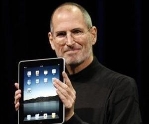 In this Jan. 27, 2010 file photo, Apple CEO Steve Jobs shows off the new iPad during an Apple event in San Francisco.