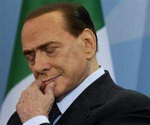 In this on Wednesday, Jan. 12, 2011 file photo Italian Prime Minister Silvio Berlusconi listens during a news conference.
