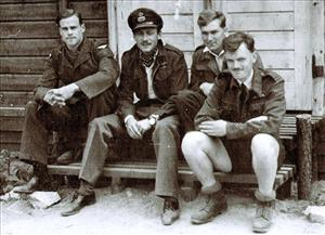 Jack Harrison, right, thought to be the last survivor of the WWII POW breakout from Stalag Luft III that inspired The Great Escape, is seen with other prisoners-of-war in this undated file photo.