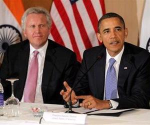In this Nov. 6, 2010 file photo, General Electric's Jeffrey Immelt, looks on as President Barack Obama speaks at a roundtable discussion with business leaders in Mumbai, India.