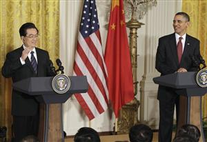 President Barack Obama and China's President Hu Jintao takes part in a joint news conference, , Wednesday, Jan. 19, 2011, in the East Room of the White House in Washington.