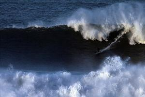 A wave crashes at Mavericks.