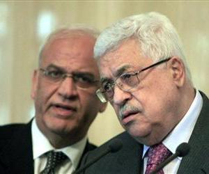 Palestinian authority President Mahmoud Abbas, right, listens to Senior Palestinian negotiator Saeb Erekat during a press conference, Jan. 24, 2011.