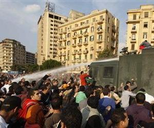 Police use a water cannon against protesters during a demonstration in downtown Cairo, Egypt Tuesday, Jan. 25, 2011.