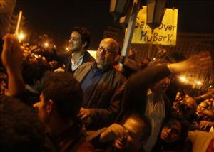 Egyptian Nobel Peace laureate and democracy advocate Mohamed ElBaradei arrives to address the crowd at Tahrir Square in Cairo, Egypt, Sunday.