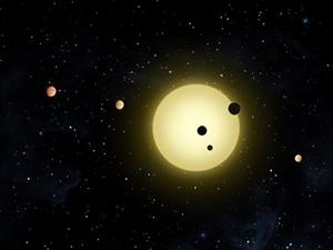This rendering shows Kepler-11, a sun-like star around which six planets orbit outside our galaxy.