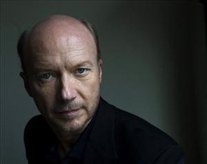 Director Paul Haggis poses for a photograph in Toronto on Thursday, Nov. 18, 2010, to promote his film The Next Three Days.