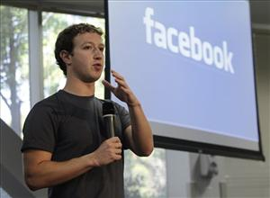 Facebook CEO Mark Zuckerberg gestures during a product announcement at Facebook headquarters in Palo Alto, Calif.