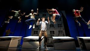 In this theater publicity image released by The O and M Co., Reeve Carney, center, portrays Peter Parker in a scene from the musical Spider-Man: Turn Off the Dark, in New York.