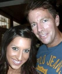 This undated Jan. 4, 2011, file  photo provided by a family friend shows former Anheuser-Busch CEO August Busch IV, right, and his girlfriend Adrienne Martin.